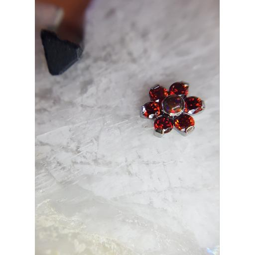 Ruby red gem and synthetic opal flower