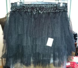 Mini layered black skirt with bow detail.